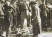 photograph - A suffragette falls to the ground