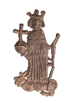 Pewter badge of King Henry VI. He wears robes of state and holds an orb in his right hand and a sceptre in his left. An antelope with a forked tail and serrated horns lies at his feet.