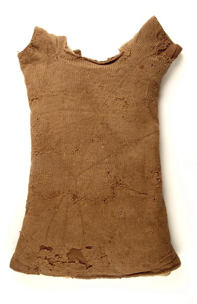 Knitted woollen vest with short sleeves. The wool is brown.
